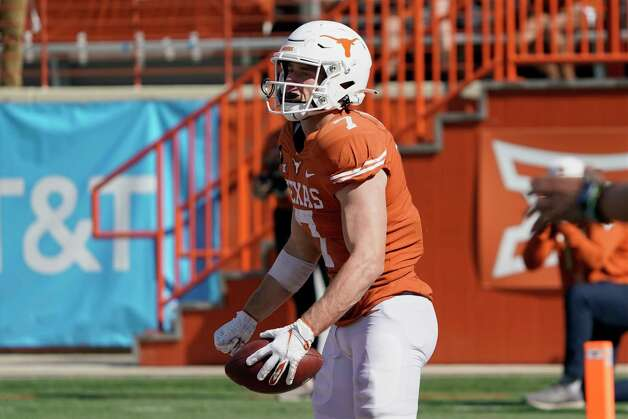 Texas' Jake Smith (7) reacts after his touchdown catch against West Virginia during the second half of an NCAA college football game in Austin, Texas, Saturday, Nov. 7, 2020. (AP Photo/Chuck Burton) Photo: Chuck Burton, Associated Press / Copyright 2020 The Associated Press. All rights reserved.