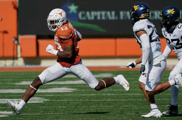 Texas' Brennan Eagles (13) runs after a catch against West Virginia during the second half of an NCAA college football game in Austin, Texas, Saturday, Nov. 7, 2020. (AP Photo/Chuck Burton) Photo: Chuck Burton, Associated Press / Copyright 2020 The Associated Press. All rights reserved.