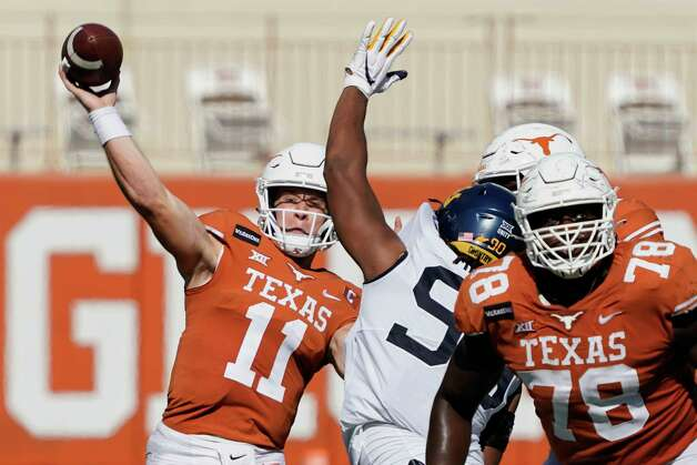 Texas' Sam Ehlinger (11) throws a pass against West Virginia during the second half of an NCAA college football game in Austin, Texas, Saturday, Nov. 7, 2020. (AP Photo/Chuck Burton) Photo: Chuck Burton, Associated Press / Copyright 2020 The Associated Press. All rights reserved.