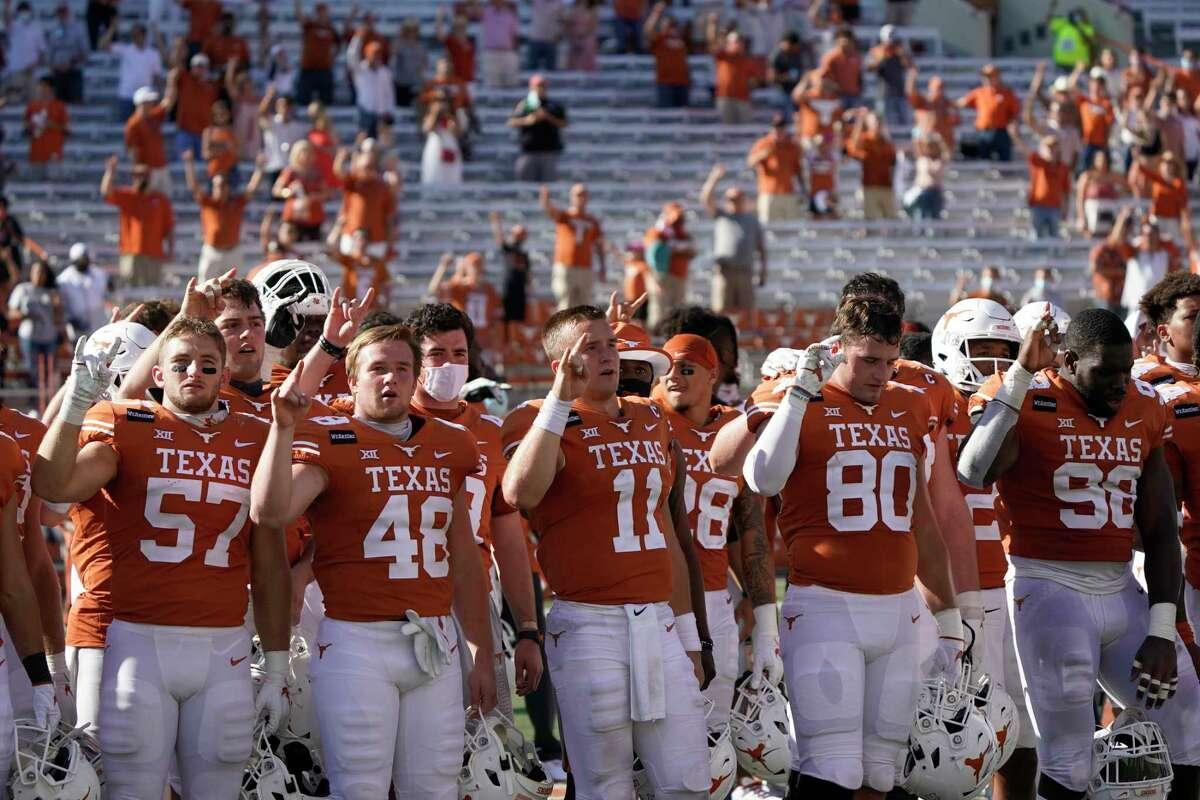 "Texas players, including Texas' Sam Ehlinger (11) sing ""The Eyes of Texas"" after an NCAA college football game against West Virginia in Austin, Texas, Saturday, Nov. 7, 2020. (AP Photo/Chuck Burton)"