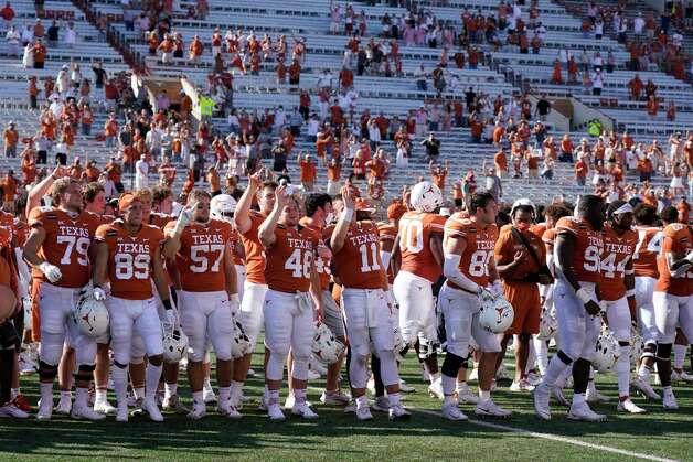 "Texas players sing ""The Eyes of Texas"" after an NCAA college football game against West Virginia in Austin, Texas, Saturday, Nov. 7, 2020. (AP Photo/Chuck Burton) Photo: Chuck Burton, Associated Press / Copyright 2020 The Associated Press. All rights reserved."