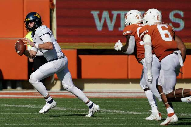 West Virginia quarterback Jarret Doege (2) scramble against Texas during the second half of an NCAA college football game in Austin, Texas, Saturday, Nov. 7, 2020. (AP Photo/Chuck Burton) Photo: Chuck Burton, Associated Press / Copyright 2020 The Associated Press. All rights reserved.