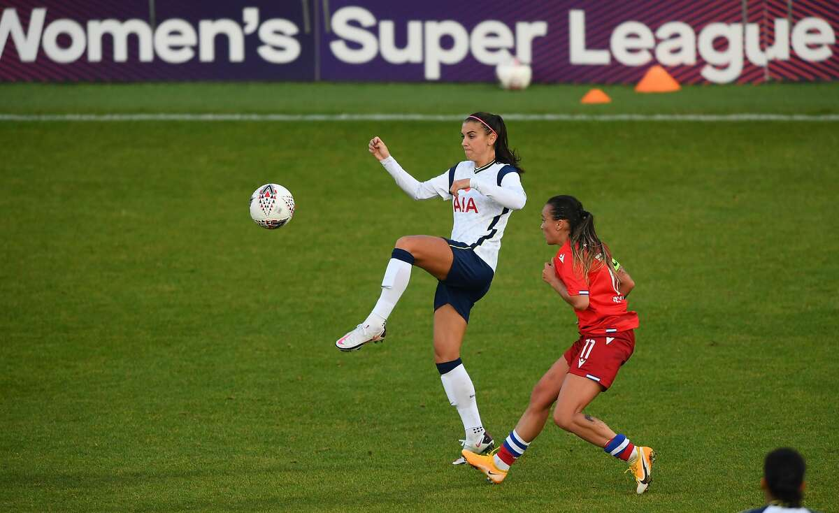 Tottenham's Alex Morgan, the U.S. national team star out of Cal, battles for the ball with Reading's Natasha Harding in her European soccer debut.