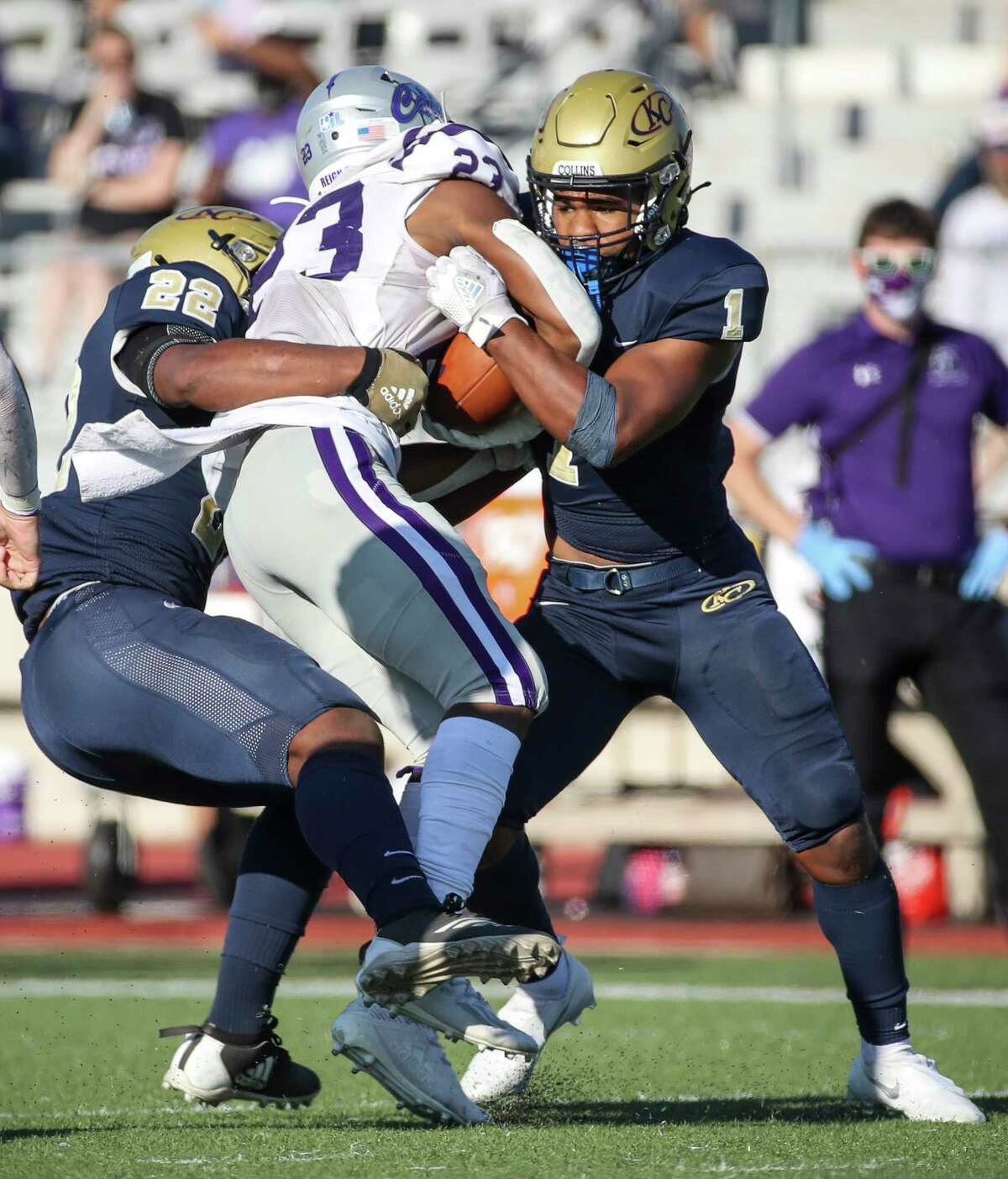 Klein Cain Hurricanes running back Jaydon Blue (23 is stopped by Klein Collins Tigers Jeremiah Hasan (1) and linebacker Jaylen Hasan (22) during the second half of a high school football game Saturday, Nov. 7, 2020, at Klein Memorial Stadium in Spring.