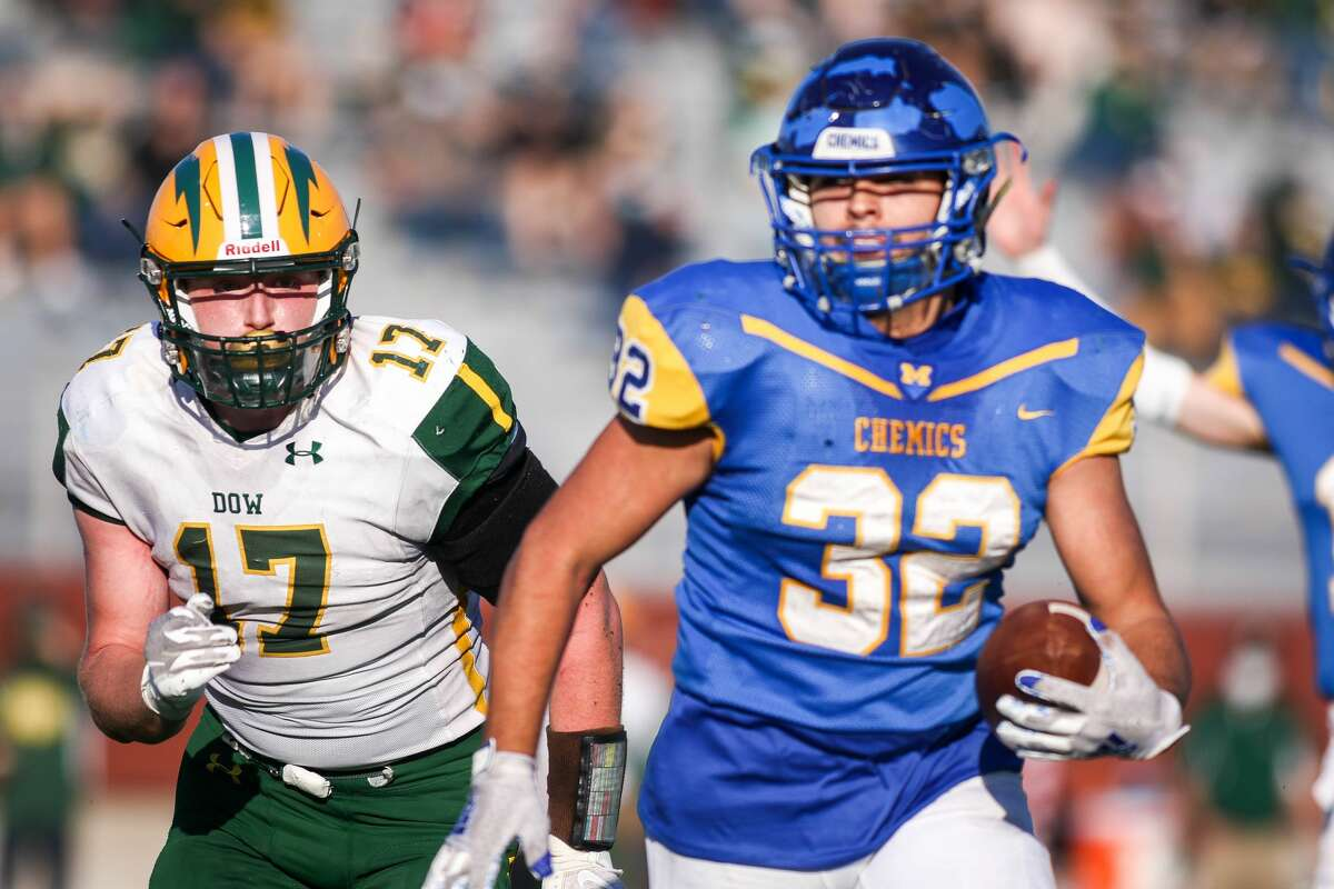Dow's Caleb Brenske chases down Midland's Drew Johnson during their district final Saturday, Nov. 7, 2020 at Midland Community Stadium. (Cody Scanlan/for The Daily News)