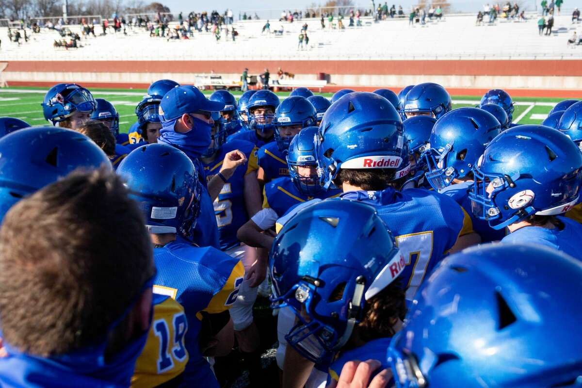 The Midland Chemics huddle after their district finals victory over Dow Saturday, Nov. 7, 2020 at Midland Community Stadium. (Cody Scanlan/for The Daily News)