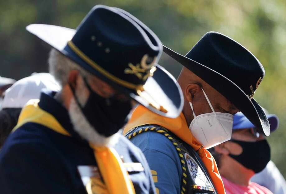 Robert Coleman, of the National Association of Buffalo Soldiers, prays beside Billy Ray Smith during a dedication for Conroe Community Cemetery. Photo: Jason Fochtman, Houston Chronicle / Staff Photographer / 2020 © Houston Chronicle