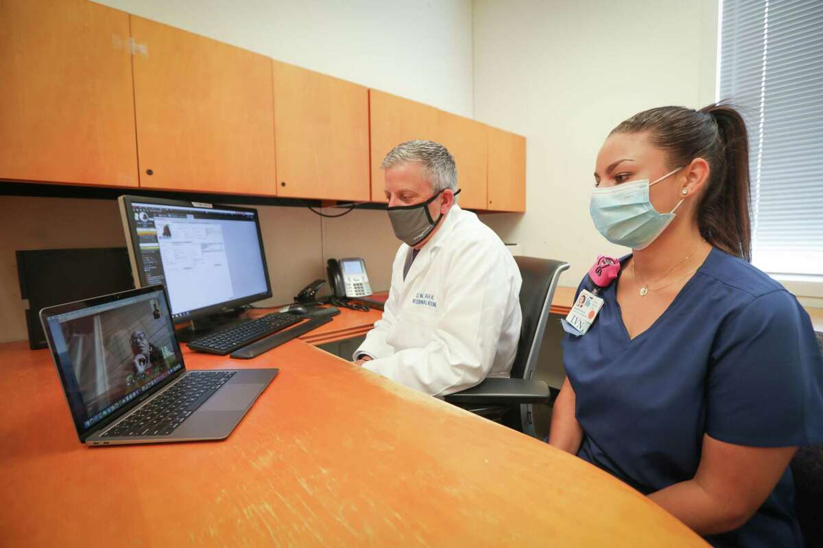 Kelsey-Seybold's Dr. Donnie Aga and LVN Rachel Robinson connect with patient Joan Starr during a telemedicine visit.