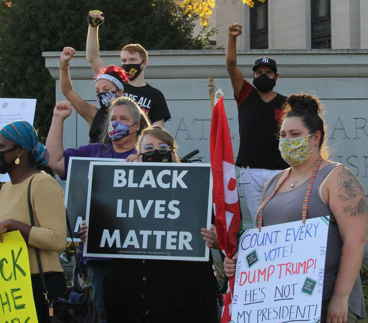 At the state Capitol on Saturday afternoon, pro-Biden and progressive groups showed up at first to calls for counting of all votes, then to celebrate the Biden win, then to stand off against pro-Trump groups. The pro-Trump protesters gathered on the south lawn of the Capitol and held a pickup truck parade as well. The groups clashed but there were no incidents of violence. One anti-Trump protester was taken into custody by police for approaching the other side and taunting. Unclear whether she was arrested. A few Trump supporters tried to drown out the progressives' rally, then left. Both groups had 200 to 300 people there, about equal in size.