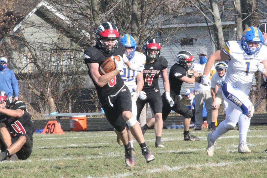Reed City's football team improved to 8-0 on Saturday with a 32-14 district semifinal win over Kingsford. Photo: John Raffel