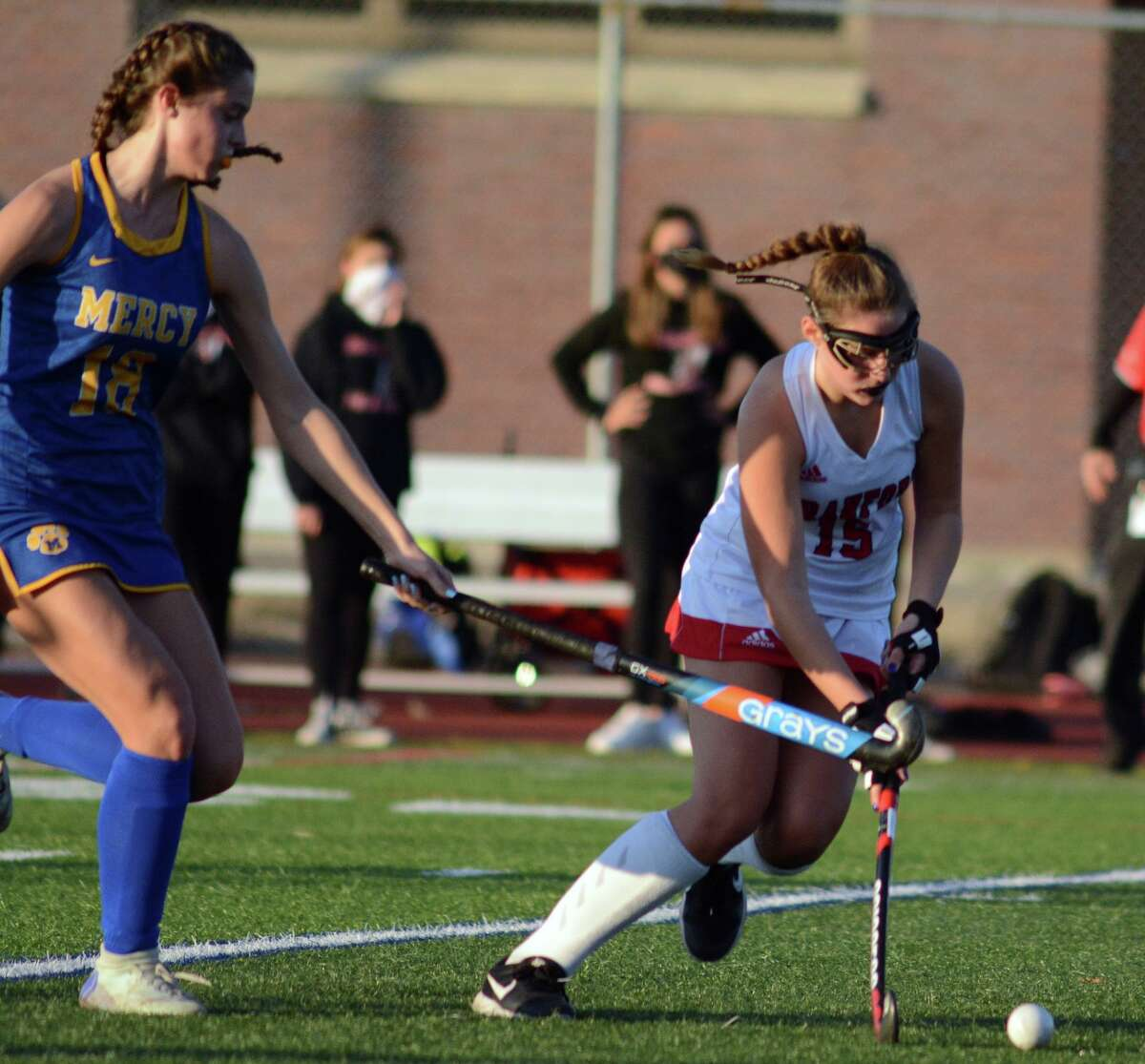 Mercy's Lily Schoonmaker and Branford's Scout Engstrom fight for the ball on Saturday.