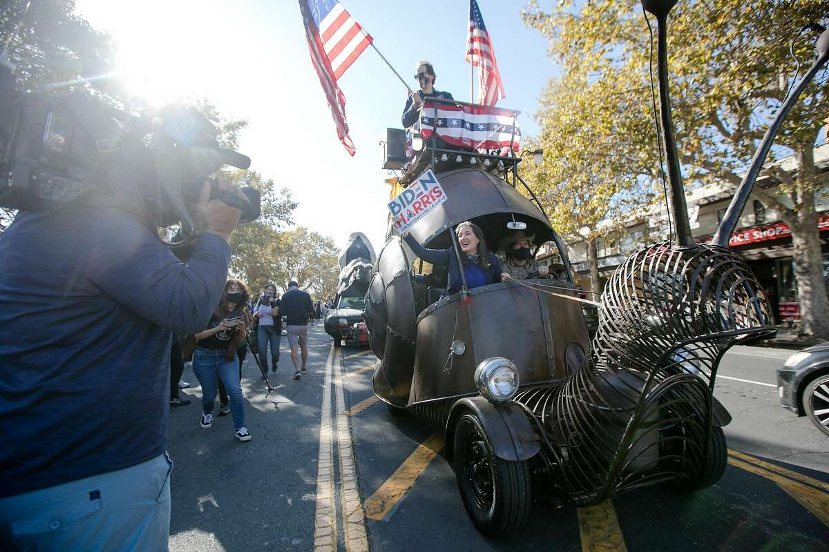 Oakland Mayor Libby Schaaf celebrate the victory of Democratic Presidential candidate Joe Biden over President Donald Trump in her snail car in Oakland, California on Nov. 7, 2020.