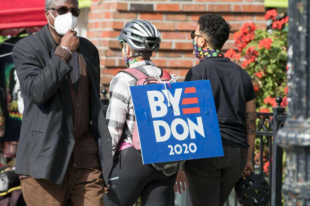 A supporters of Democratic Presidential candidate Joe Biden carries a sign celebrate Biden�s victory over President Donald Trump in Oakland, California on Nov. 7, 2020.
