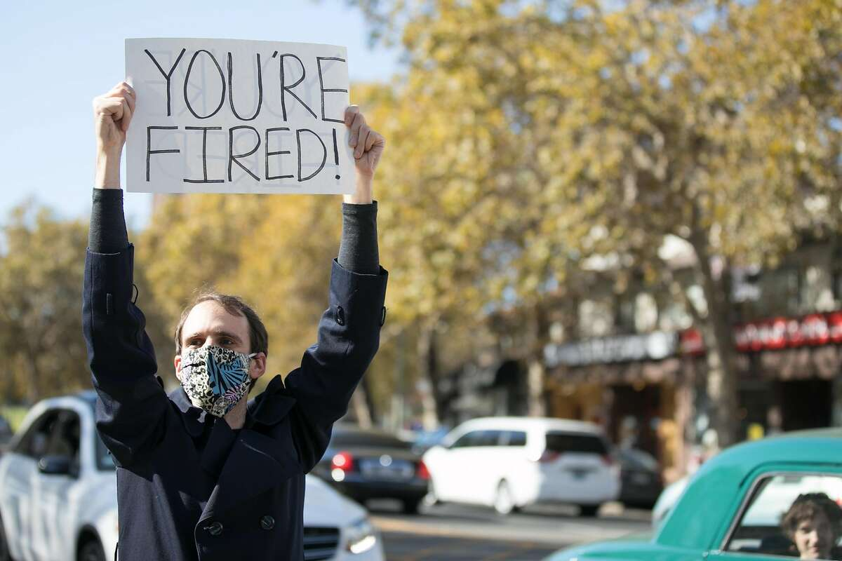 Chris Macklin holds a �You�re Fired!� sign after President Donald Trump lost the race for President in Oakland, California on Nov. 7, 2020. He was defeated by his Democratic challenger Joe Biden.