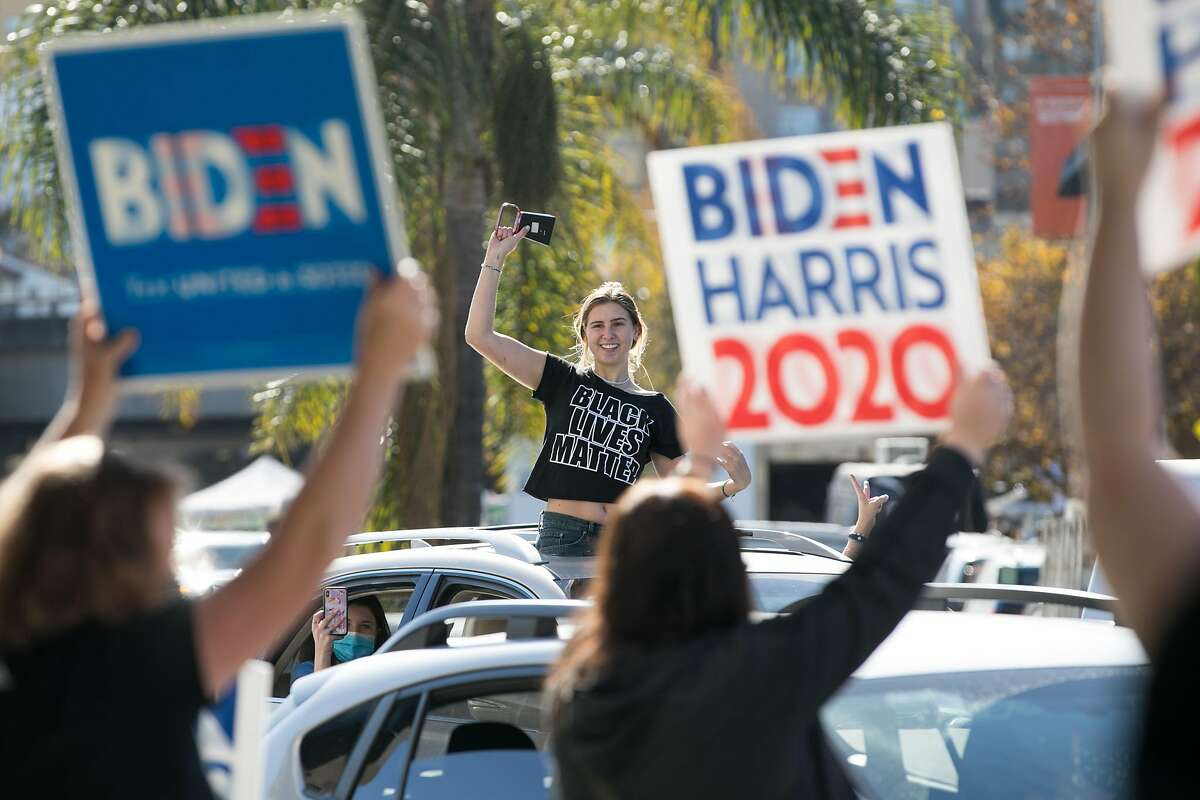 A supporters of Democratic Presidential candidate Joe Biden celebrates his victory over President Donald Trump in Oakland, California on Nov. 7, 2020.