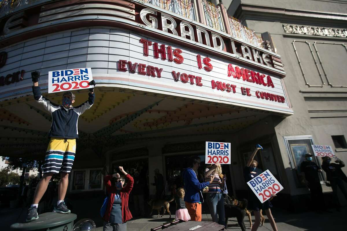 Supporters of Democratic Presidential candidate Joe Biden celebrate his victory over President Donald Trump in Oakland, California on Nov. 7, 2020 outside the Grand Lake Theater.