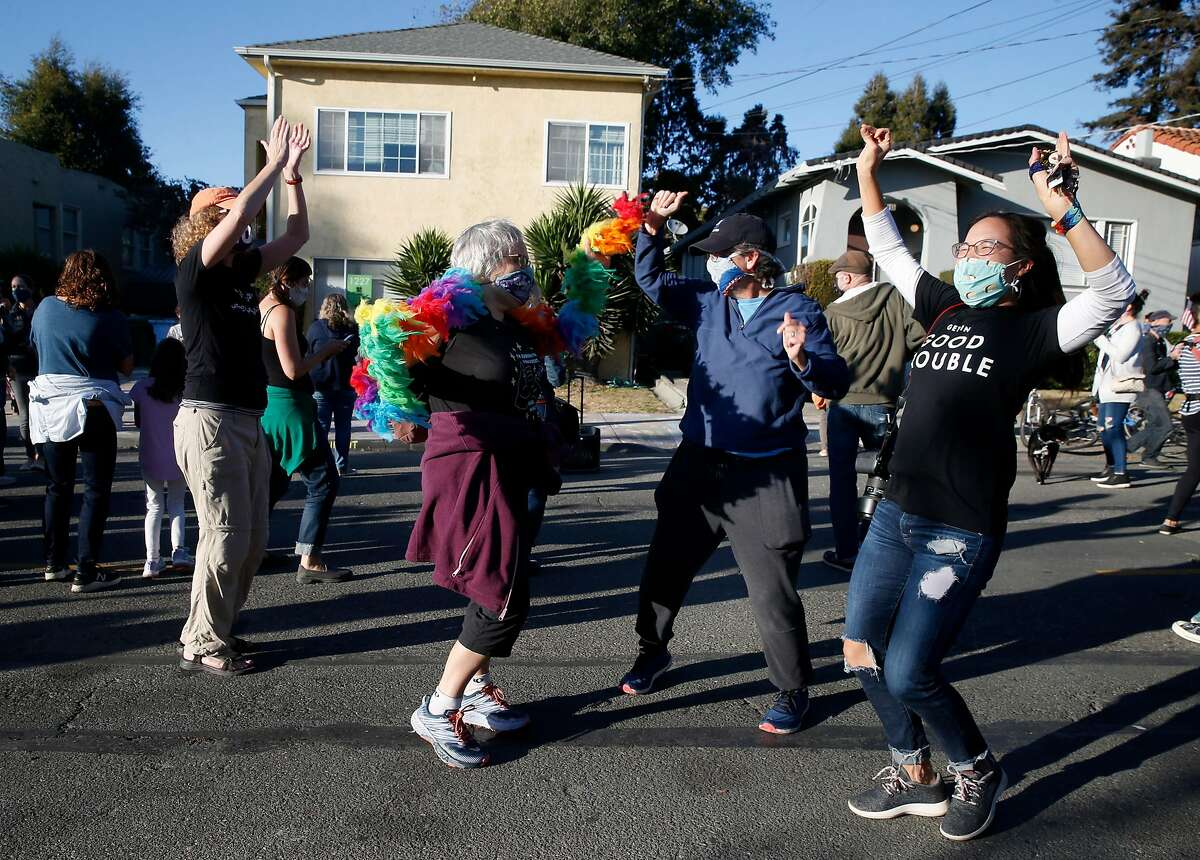 Celebrants dance in the street in front of the childhood home of Kamala Harris in Berkeley after she was declared the winner of the vice presidency in November.