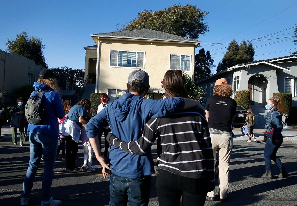 Albert Ruhi and Natalia Margolis join a large crowd celebrating Kamala Harris' vice presidential victory in front of her childhood home in Berkeley in November.