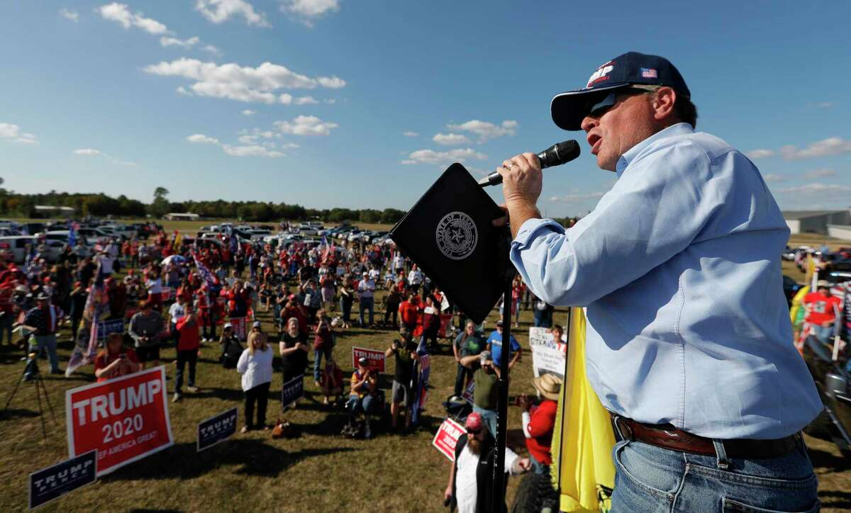 """State Rep. Steve Toth addresses a crowd of several hundred people during a """"Defend Our President"""" rally at the Montgomery County Fairgrounds, Saturday, Nov. 7, 2020, in Conroe."""