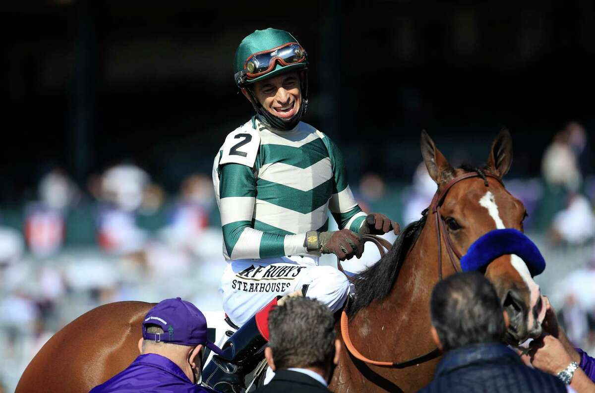 LEXINGTON, KENTUCKY - NOVEMBER 07: John Velazquez celebrates after riding Gamine to victory in the Filly and Mare Sprint during 2020 Breeders' Cup at Keeneland on November 07, 2020 in Lexington, Kentucky.