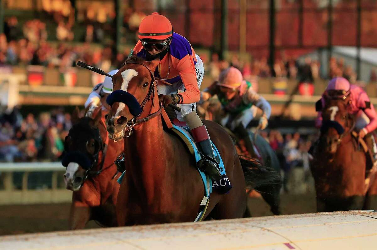 LEXINGTON, KENTUCKY - NOVEMBER 07: Authentic with John Velazquez aboard runs to victory in the Breeders' Cup Classic during 2020 Breeders' Cup at Keeneland on November 07, 2020 in Lexington, Kentucky.