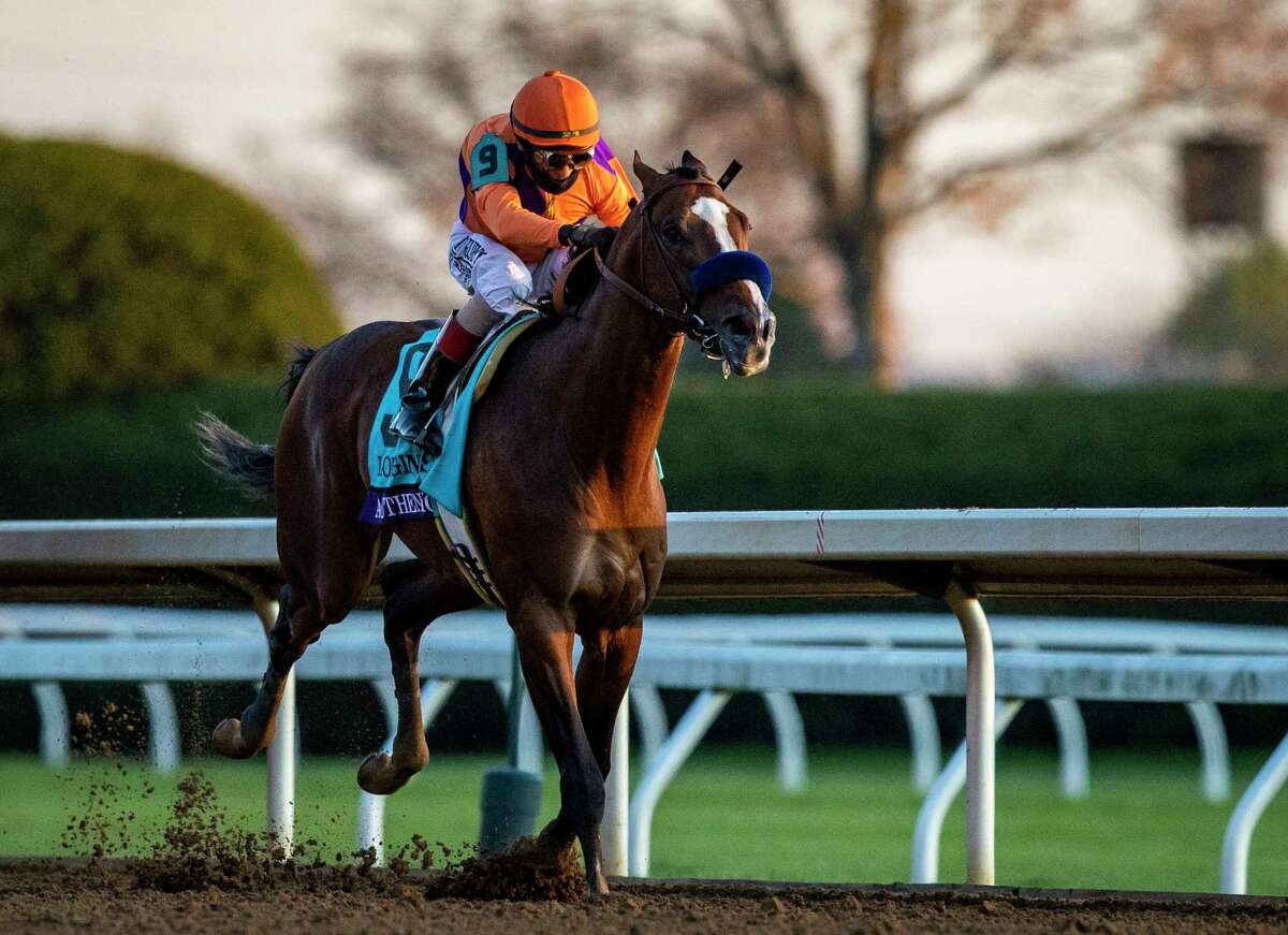 LEXINGTON, KY - NOVEMBER 07: Authentic, ridden by John Velazquez races towards the finish line during the Breeders Cup Classic at Keenland on November 7, 2020 in Lexington, Kentucky.