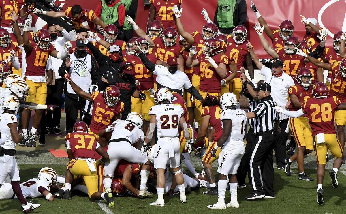 The USC bench signals possession after Arizona State wide receiver Ricky Pearsall mishandled an onside kick.