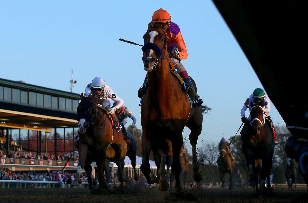 Authentic with John Velazquez aboard runs to victory in the Breeders' Cup Classic during at Keeneland in Lexington, Ky.