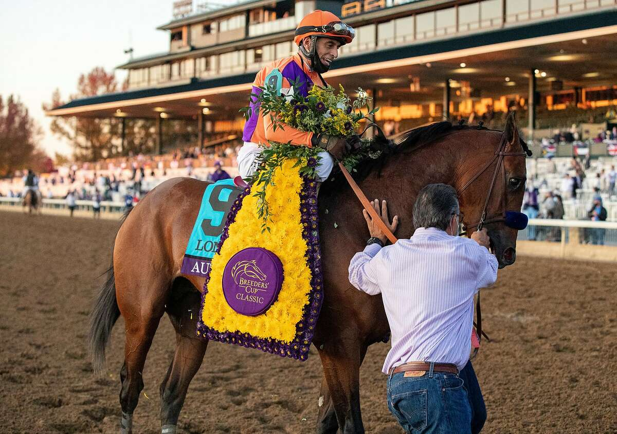 LEXINGTON, KY - NOVEMBER 07: John Velazquez walks Authentic to the winners circle after winning the Breeders Cup Classic at Keenland on November 7, 2020 in Lexington, Kentucky. (Photo by Bobby Ellis/Getty Images)