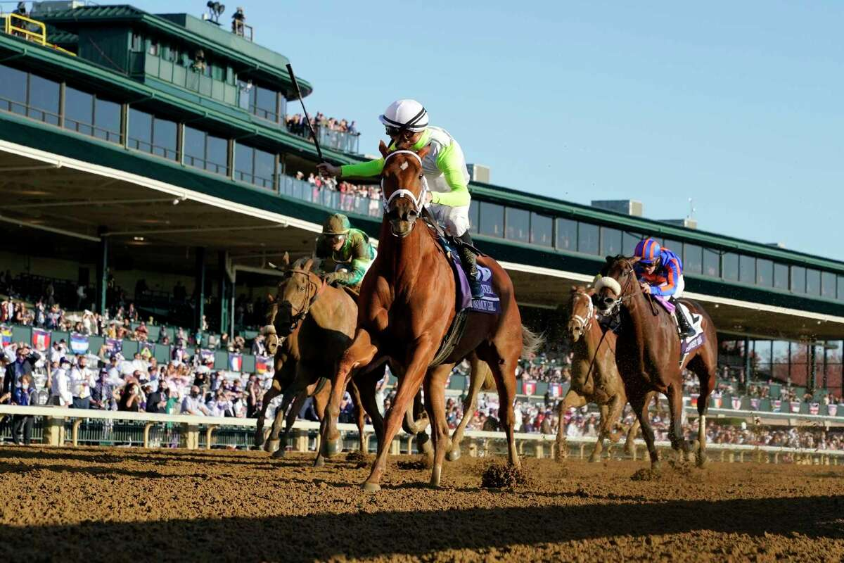 Florent Geroux rides Monomoy Girl to win the Breeders' Cup Distaff horse race at Keeneland Race Course, in Lexington, Ky., Saturday, Nov. 7, 2020.