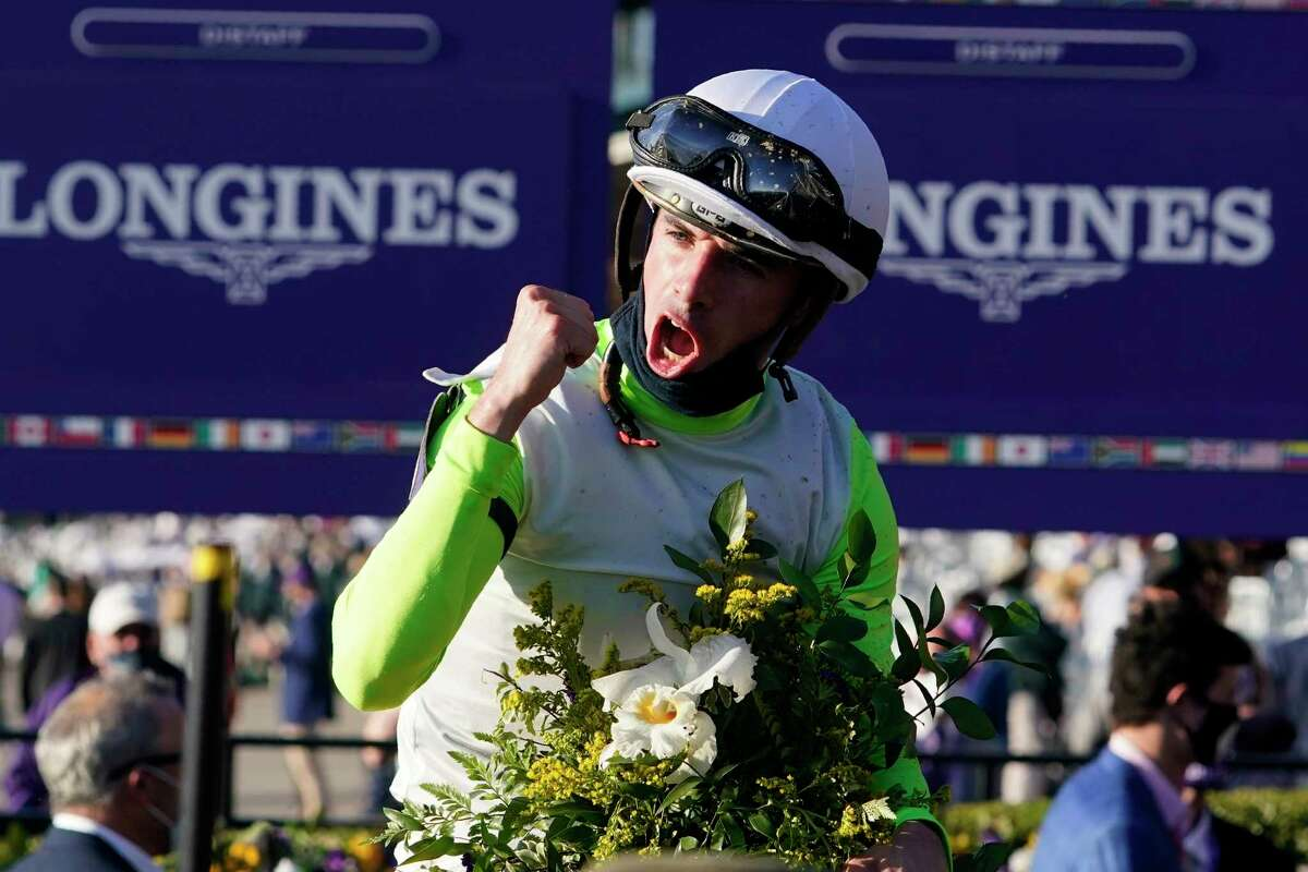 Florent Geroux celebrates after riding Monomoy Girl to win the Breeders' Cup Distaff horse race at Keeneland Race Course, in Lexington, Ky., Saturday, Nov. 7, 2020.