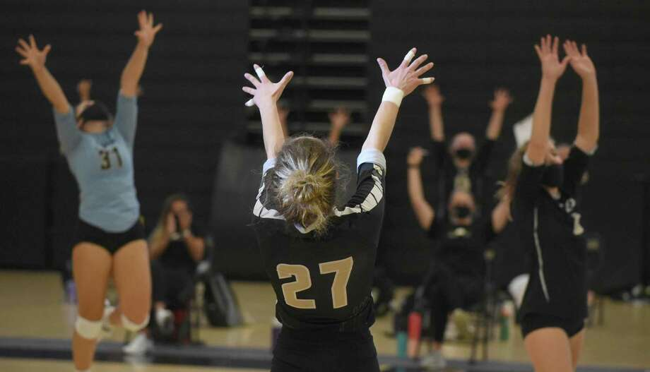 The Trumbull Eagles, including Ali Castro (27), Kat Zanvettor (31) and Bailey Cenatiempo (6) celebrate a point during the FCIAC East Region girls volleyball final against Ludlowe in Trumbull on Saturday. Photo: Dave Stewart / Hearst Conncticut Media / Hearst Connecticut Media