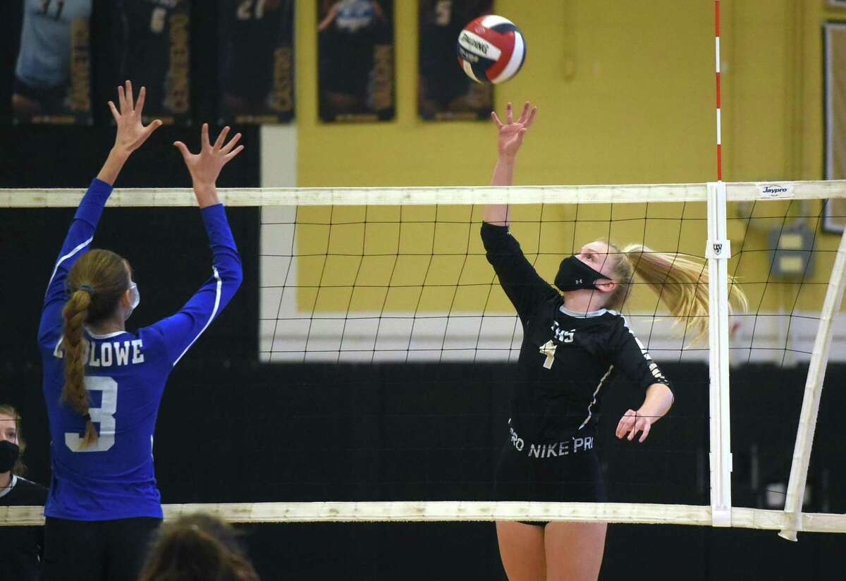 Trumbull's Stephanie Olah (4) sends a shot at Ludlowe's Natalie Reilly (3) during the FCIAC East Region girls volleyball final in Trumbull on Saturday, Nov. 7, 2020.