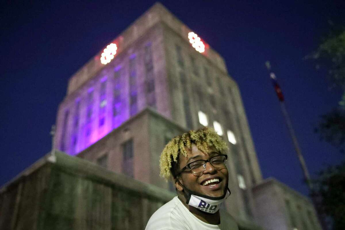 Quintarius Oliver smiles during a celebratory rally Saturday, Nov. 7, 2020, at Houston City Hall in Houston. Earlier in the day, several news organizations called Pennsylvania for Joe Biden, which would give him the 270 electoral votes needed to become the next president. Oliver said he had five family members who had never voted, but that he helped motivate them to vote.