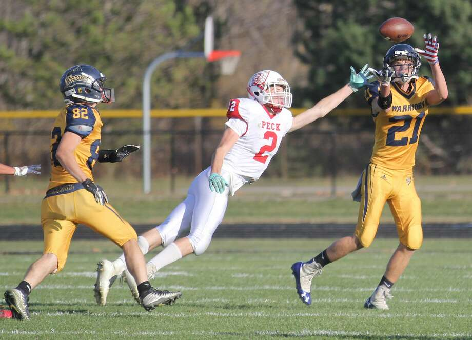 The North Huron varsity football team advanced to the regional finals with a 34-14 win over the Peck Pirates on Saturday afternoon. Photo: Mark Birdsall/Huron Daily Tribune