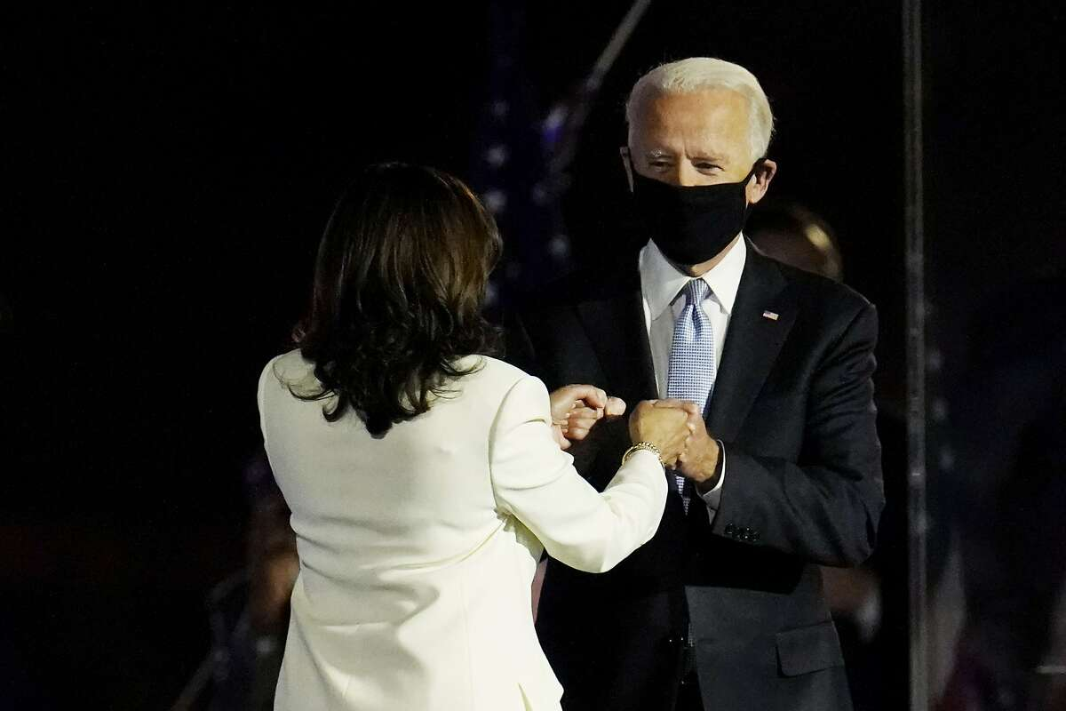 President-elect Joe Biden is greeted on stage by Vice President-elect Kamala Harris before he speaks in Wilmington, Del., Saturday, Nov. 7, 2020.