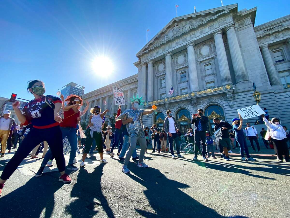 People celebrate the victory of Joe Biden in front of San Francisco's City Hall on Nov. 7, 2020.