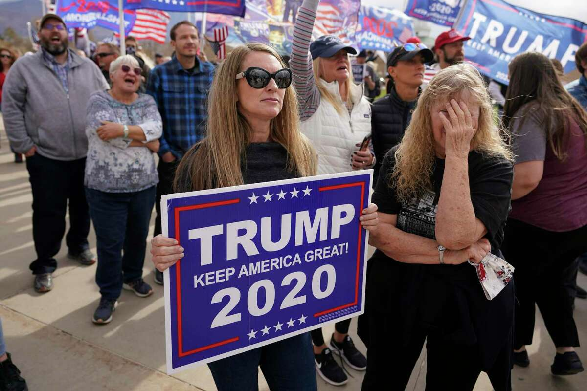 Supporters of President Donald Trump rally outside the Utah State Capitol on Saturday, Nov. 7, 2020, in Salt Lake City. Democrat Joe Biden defeated Trump to become the 46th president of the United States on Saturday. (AP Photo/Rick Bowmer)