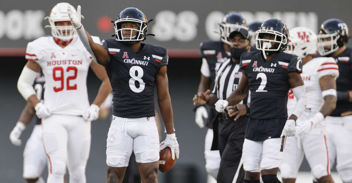 Michael Young Jr. #8 of the Cincinnati Bearcats signals a first down during the first half against the Houston Cougars at Nippert Stadium on November 7, 2020 in Cincinnati, Ohio. (Photo by Michael Hickey/Getty Images)
