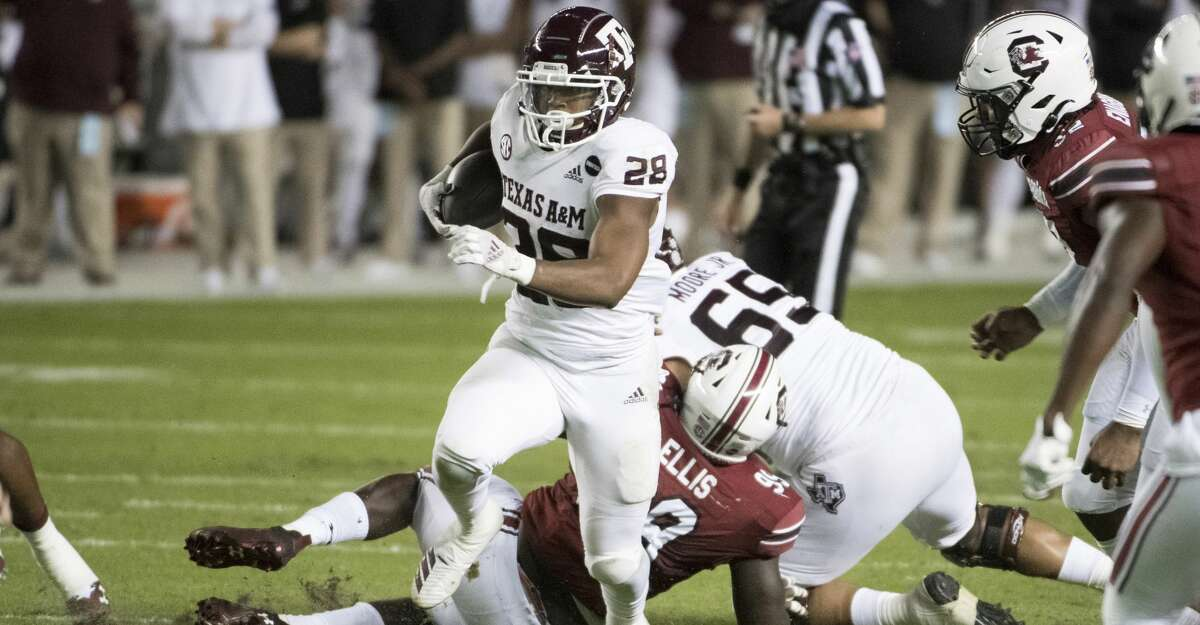 Texas A&M running back Isaiah Spiller (28) carries the ball against South Carolina during the first half of an NCAA college football game Saturday, Nov. 7, 2020, in Columbia, S.C. (AP Photo/Sean Rayford)