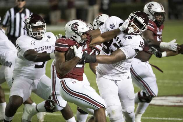 South Carolina running back Kevin Harris (20) stiff-arms Texas A&M defensive lineman Jayden Peevy (92) during the first half of an NCAA college football game Saturday, Nov. 7, 2020, in Columbia, S.C. (AP Photo/Sean Rayford) Photo: Sean Rayford/Associated Press / The Associated Press
