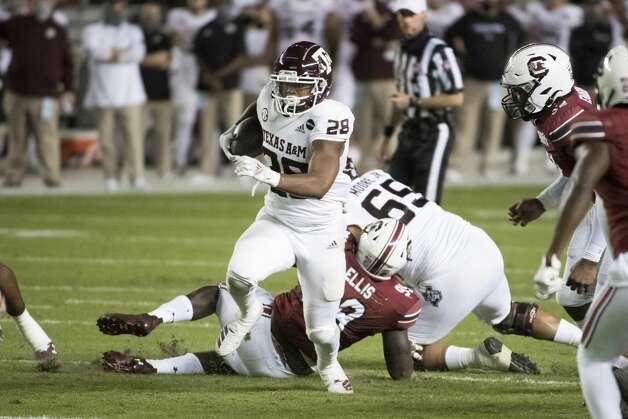 Texas A&M running back Isaiah Spiller (28) carries the ball against South Carolina during the first half of an NCAA college football game Saturday, Nov. 7, 2020, in Columbia, S.C. (AP Photo/Sean Rayford) Photo: Sean Rayford/Associated Press / Copyright 2020 The Associated Press. All rights reserved