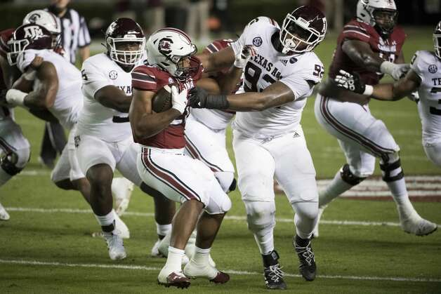 Texas A&M defensive lineman Jayden Peevy (92) tackles South Carolina running back Kevin Harris (20) during the first half of an NCAA college football game Saturday, Nov. 7, 2020, in Columbia, S.C. (AP Photo/Sean Rayford) Photo: Sean Rayford/Associated Press / The Associated Press