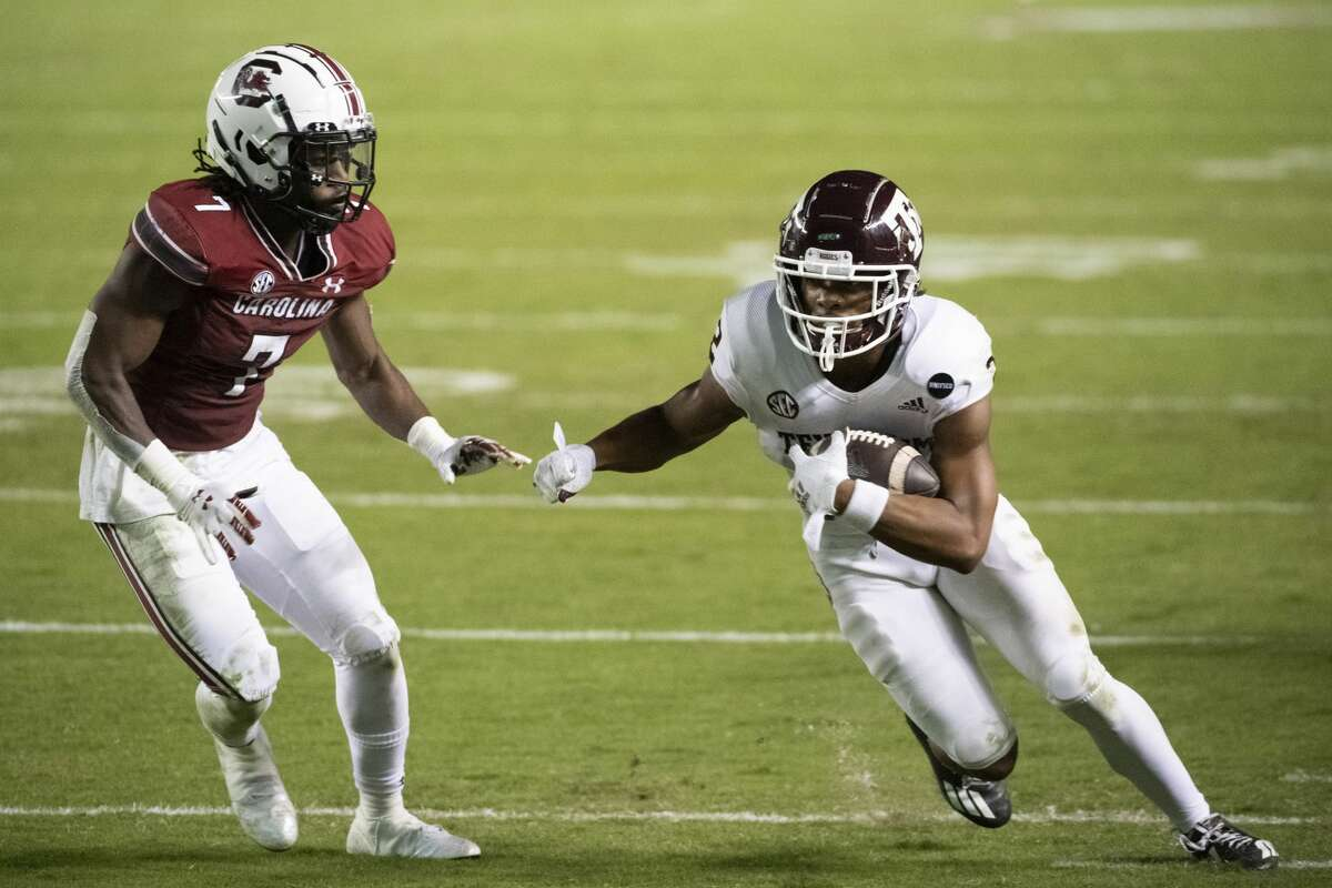 Texas A&M wide receiver Chase Lane (2) carries the ball next to South Carolina defensive back Jammie Robinson (7) during the second half of an NCAA college football game Saturday, Nov. 7, 2020, in Columbia, S.C. (AP Photo/Sean Rayford)