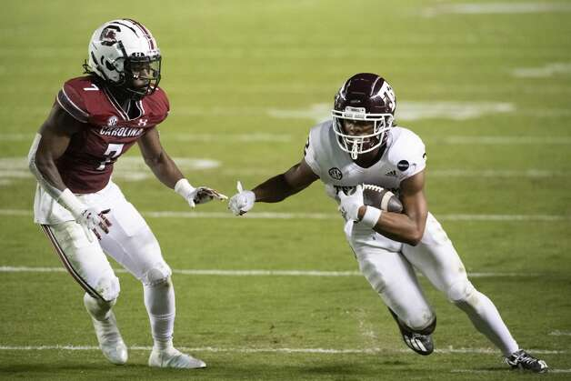 Texas A&M wide receiver Chase Lane (2) carries the ball next to South Carolina defensive back Jammie Robinson (7) during the second half of an NCAA college football game Saturday, Nov. 7, 2020, in Columbia, S.C. (AP Photo/Sean Rayford) Photo: Sean Rayford/Associated Press / The Associated Press