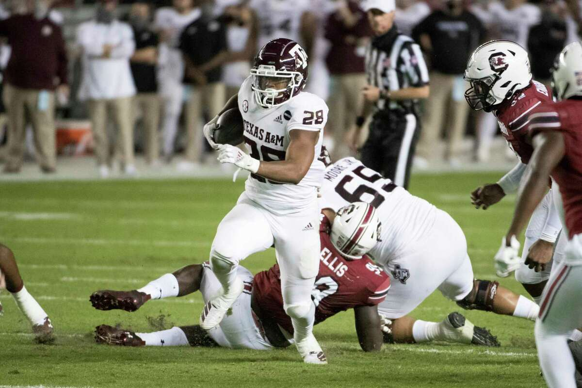 Texas A&M running back Isaiah Spiller rushed 18 times for 131 yards and had 46 receiving yards before leaving in the third quarter with what appeared to be a right leg injury.
