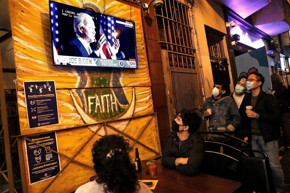 Diners at Puerto Alegre on Valencia Street listen to US President-elect Joe Biden give his victory speech on a television screen in San Francisco, Calif., on Saturday, November 7, 2020.