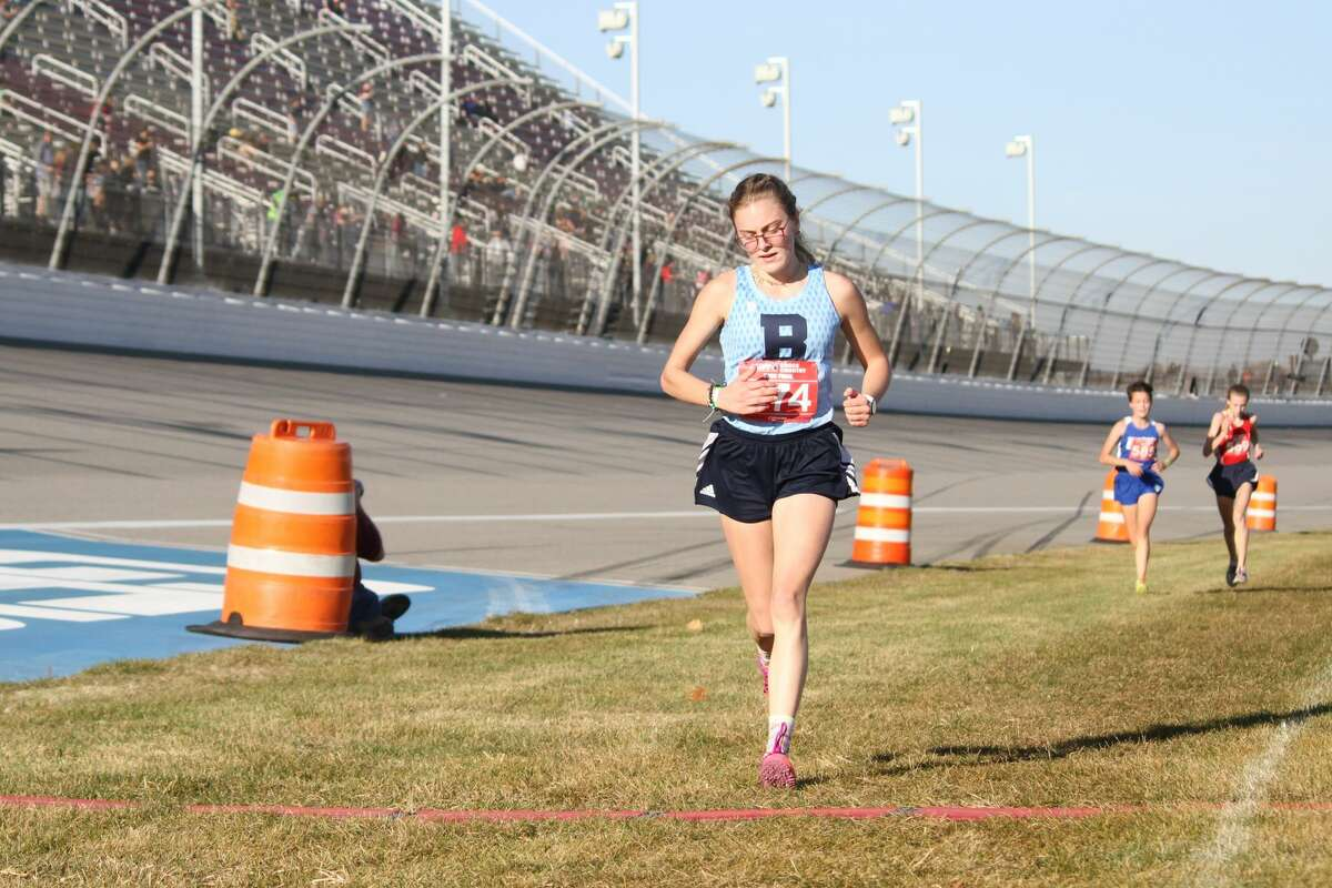Brethren's Alexis Tracy races to her second all-state finish in cross country on Nov. 7.