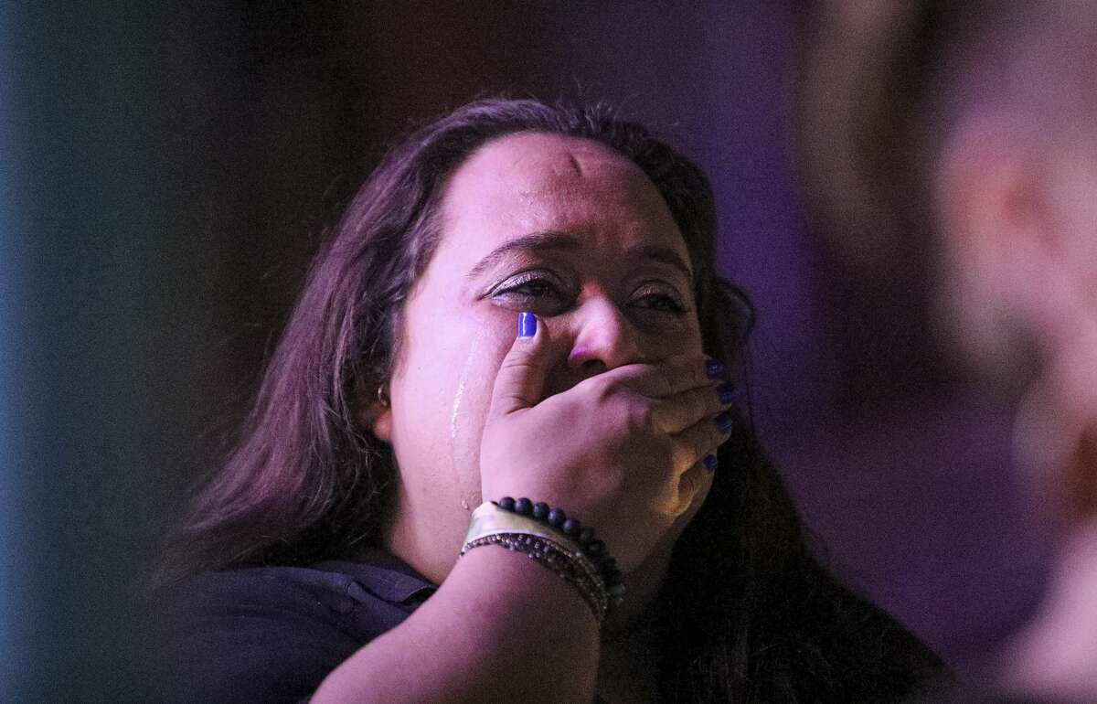 Tanya Djavadzadeh cries as she listens to President-elect Joe Biden speak on TV during a watch party Saturday, Nov. 7, 2020, at Axelrad in Houston.