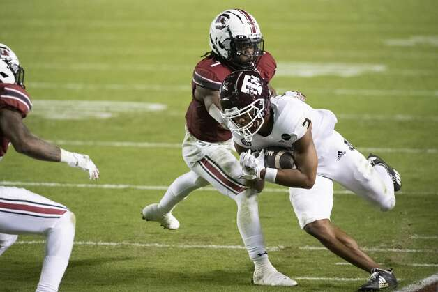 Texas A&M wide receiver Chase Lane (2) is knocked out of bounds by South Carolina defensive back Jammie Robinson (7) during the second half of an NCAA college football game Saturday, Nov. 7, 2020, in Columbia, S.C. Texas A&M won 48-3. (AP Photo/Sean Rayford) Photo: Sean Rayford/Associated Press / The Associated Press